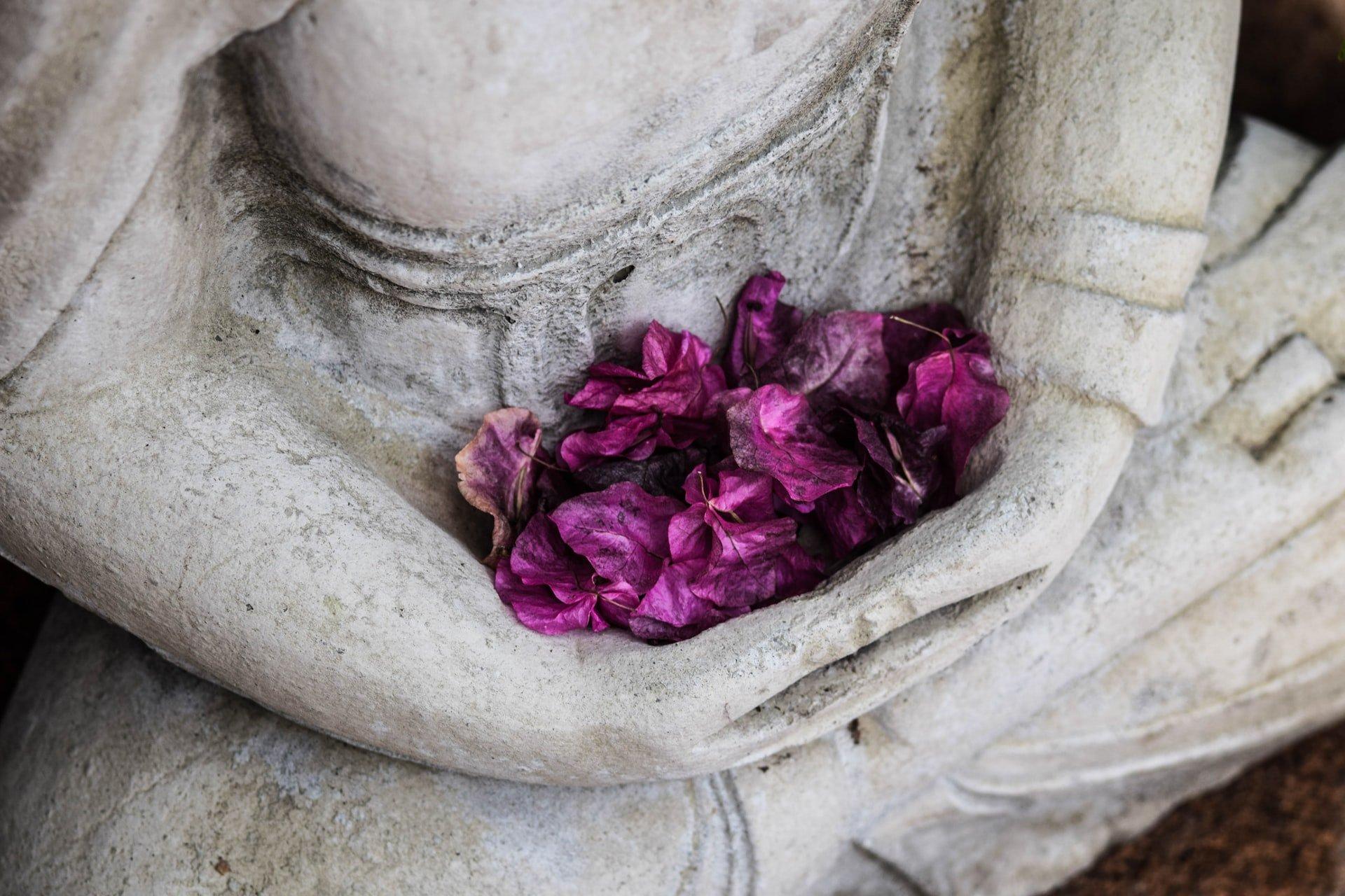 Statue holding flower petals
