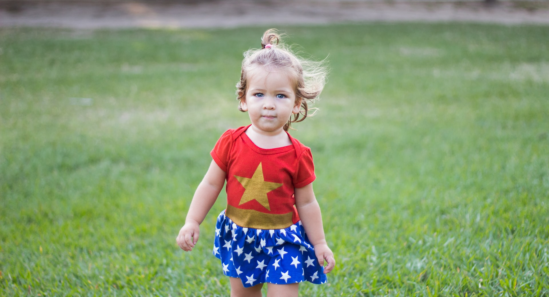Little girl wearing superhero outfit